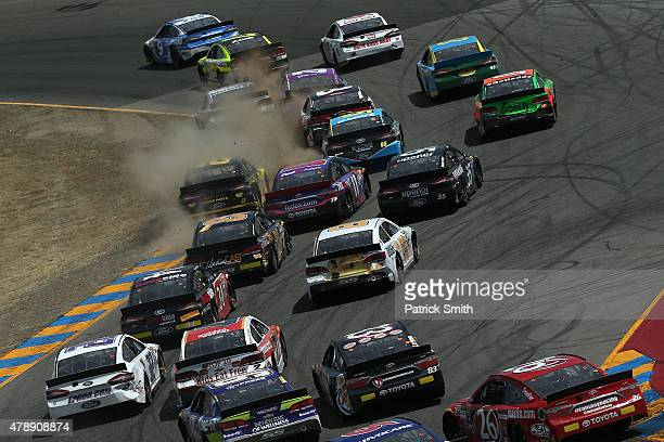 Sam Hornish Jr driver of the Jacob Companies Ford leads a pack of cars during the NASCAR Sprint Cup Series Toyota/Save Mart 350 at Sonoma Raceway on...
