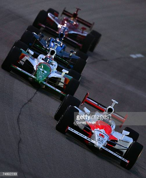 Sam Hornish Jr driver of the Marlboro Team Penske Dallara Honda leads Tony Kanaan driver of the Team 7Eleven Andretti Green Racing Dallara Honda and...