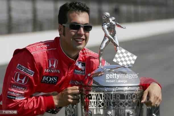 Sam Hornish Jr driver of the Marlboro Team Penske Dallara Honda poses with the BorgWarner Trophy during the official trophy presentation for the IRL...
