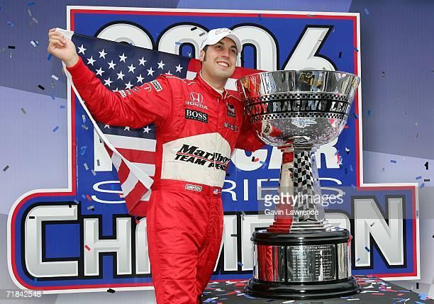 Sam Hornish Jr driver of the Marlboro Team Penske Dallara Honda celebrates winning the championship during the Indy Racing League IndyCar Series Peak...