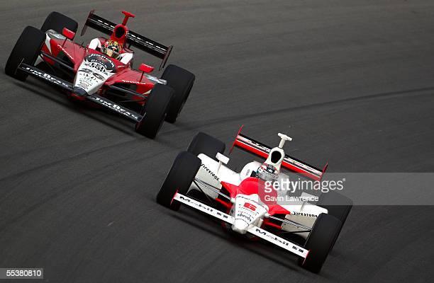 Sam Hornish Jr driver of the Marlboro Team Penske Dallara Toyota is chased down by Dan Wheldon driver of the Klein Tools/Jim Beam Andretti Green...