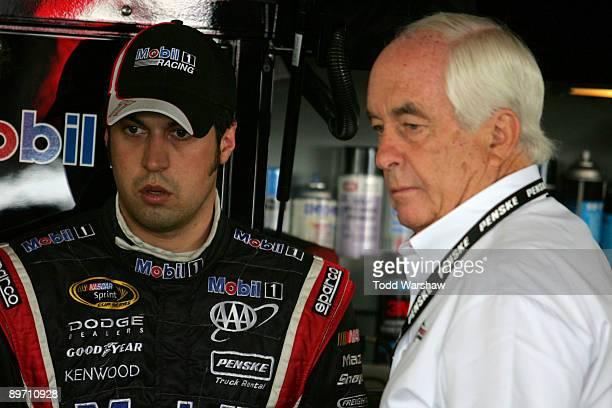Sam Hornish Jr. , driver of the Mobil 1 Dodge, talks with team owner Roger Penske during practice for the NASCAR Sprint Cup Series Heluva Good! Sour...