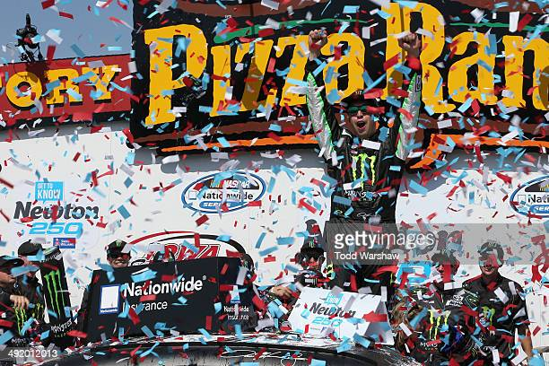 Sam Hornish Jr driver of the Monster Energy Toyota celebrates in victory lane after winning the NASCAR Nationwide Series Get To Know Newton 250...