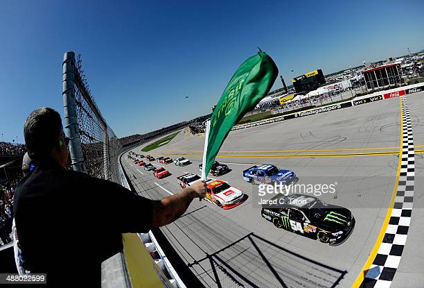 Sam Hornish Jr driver of the Monster Energy Toyota leads the field at the start of the NASCAR Nationwide Series Aaron's 312 at Talladega...