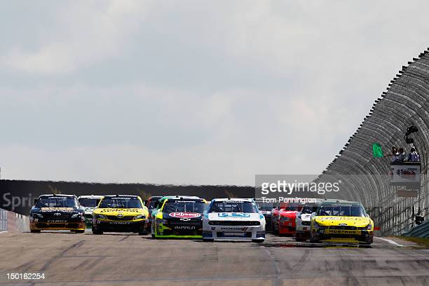 Sam Hornish Jr driver of the PPG Dodge leads Carl Edwards driver of the Subway Dodge and the rest of the field past the green flag to start the...
