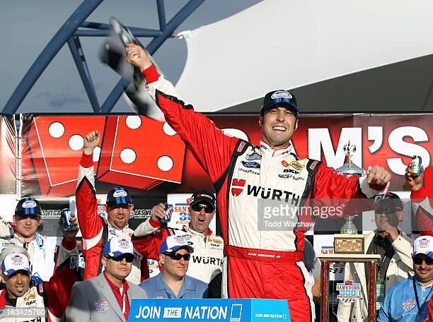 Sam Hornish Jr driver of the Wurth Ford celebrates in Victory Lane after winning the NASCAR Nationwide Series Sam's Town 300 at Las Vegas Motor...