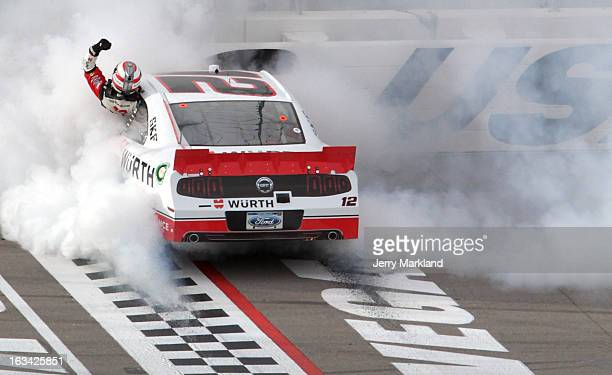 Sam Hornish Jr driver of the Wurth Ford celebrates with a burnout after winning during the NASCAR Nationwide Series Sam's Town 300 at Las Vegas Motor...