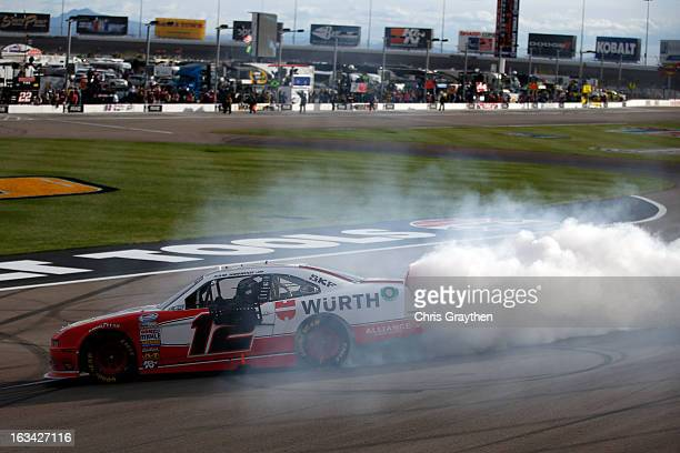 Sam Hornish Jr driver of the Wurth Ford celebrates with a burnout after winning the NASCAR Nationwide Series Sam's Town 300 at Las Vegas Motor...