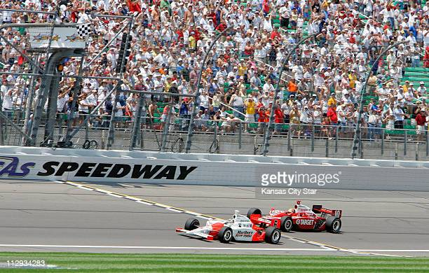 Sam Hornish Jr takes the checkered flag and the victory just ahead of Dan Wheldon at the Kansas Lottery Indy 300 at Kansas Speedway in Kansas City...