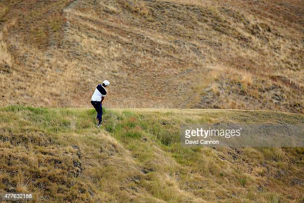 Sam Horsfield of England hits his third shot on the ninth hole during the first round of the 115th US Open Championship at Chambers Bay on June 18...