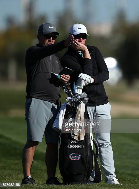 Sam Horsfield of England looks on with his caddie during round four of the European Tour Qualifying School Final Stage at Lumine Golf Club on...