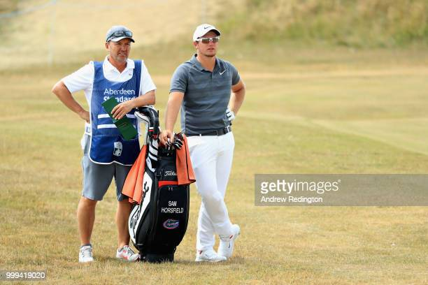 Sam Horsfield of England looks on with his caddy before taking his second shot on hole four during day four of the Aberdeen Standard Investments...