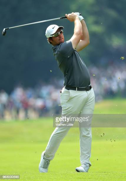 Sam Horsfield of England plays a shot from the fairway during day four and the final round of the BMW PGA Championship at Wentworth on May 27 2018 in...