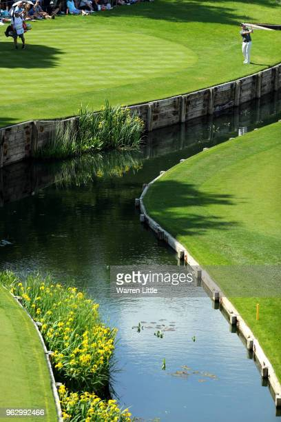 Sam Horsfield of England plays an approach on the 18th hole during day four and the final round of the BMW PGA Championship at Wentworth on May 27...