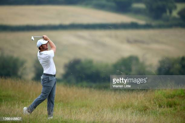Sam Horsfield of England plays his approach shot on the first hole during Day three of the Celtic Classic at the Celtic Manor Resort on August 15,...