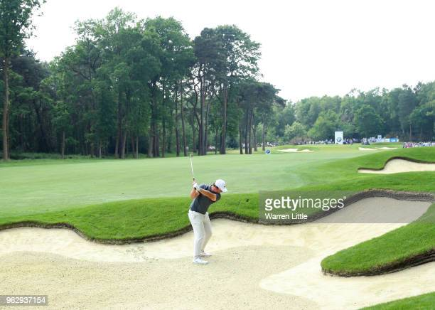 Sam Horsfield of England plays his second shot from a bunker on the 12th hole during day four and the final round of the BMW PGA Championship at...