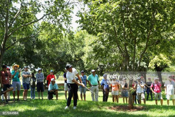 Sam Horsfield of England plays his second shot into the third green during the final round of the Tshwane Open at Pretoria Country Club on March 4...
