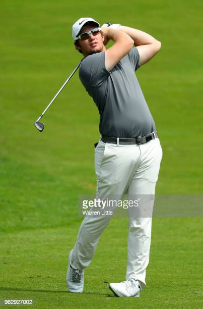 Sam Horsfield of England plays his second shot on the 7th hole during day four and the final round of the BMW PGA Championship at Wentworth on May 27...