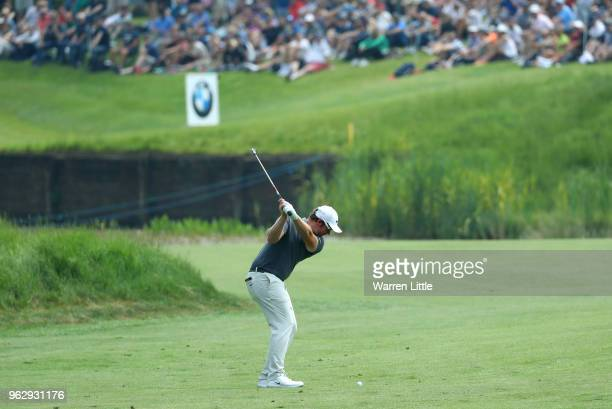 Sam Horsfield of England plays his second shot on the 8th hole during day four and the final round of the BMW PGA Championship at Wentworth on May 27...