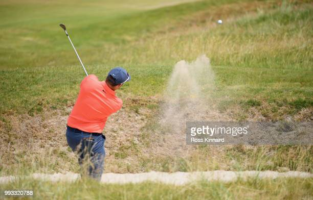 Sam Horsfield of England plays his second shot on the first hole during the third round of the Dubai Duty Free Irish Open at Ballyliffin Golf Club on...