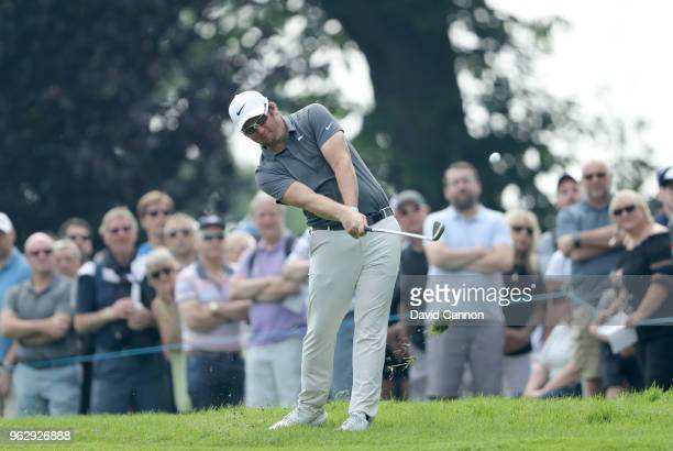 Sam Horsfield of England plays his second shot on the par 4 first hole during the final round of the 2018 BMW PGA Championship on the West Course at...