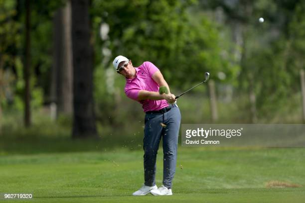 Sam Horsfield of England plays his second shot on the par 4 ninth hole during the third round of the 2018 BMW PGA Championship on the West Course at...
