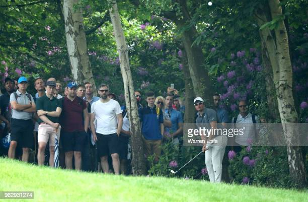 Sam Horsfield of England plays out of the trees on the 4th hole during day four and the final round of the BMW PGA Championship at Wentworth on May...