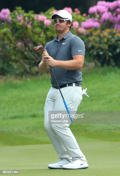 Sam Horsfield of England reacts after a putt on the 8th green during day four and the final round of the BMW PGA Championship at Wentworth on May 27...