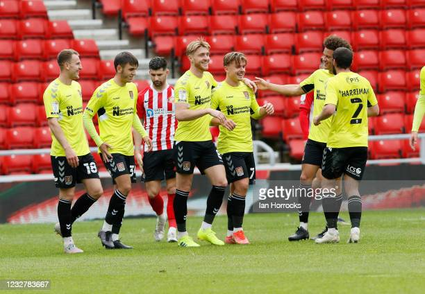 Sam Hoskins of Northampton celebrates after he scores the opening goal with a deflected free kick during the Sky Bet League One match between...