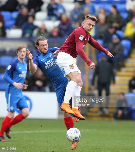 Sam Hoskins of Northampton Town contests the ball with Jack Marriott of Peterborough United during the Sky Bet League One match between Peterborough...