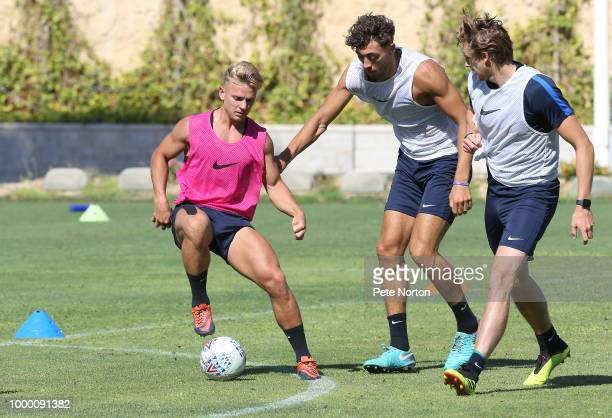Sam Hoskins of Northampton Town controls the ball watched by team mates Matt Crooks and Ash Taylor during a training session at Lomas de Campoamor on...