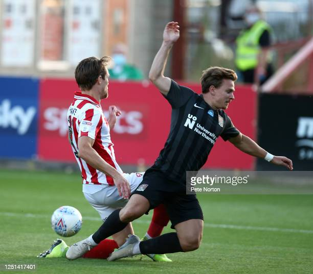 Sam Hoskins of Northampton Town goes to ground under pressure from Charlie Raglan of Cheltenham Town during the Sky Bet League Two Play Off Semifinal...