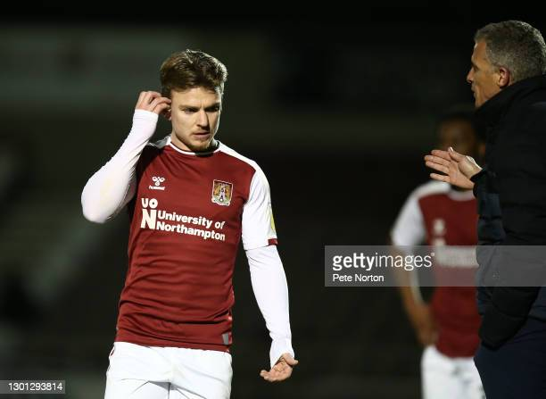 Sam Hoskins of Northampton Town listens as manager Keith Curle gives instructions during the Sky Bet League One match between Northampton Town and...