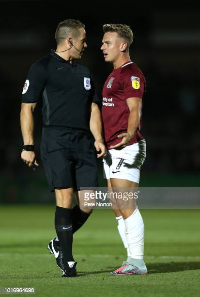 Sam Hoskins of Northampton Town remonstrates with referee Staphen Martin during the Carabao Cup First Round match between Wycombe Wanderers and...