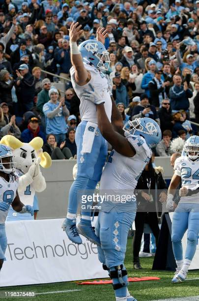 Sam Howell of the North Carolina Tar Heels celebrates with Jordan Tucker after catching a touchdown against the Temple Owls in the Military Bowl...