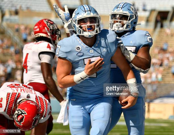 Sam Howell of the North Carolina Tar Heels reacts after scoring a touchdown against the North Carolina State Wolfpack during their game at Kenan...