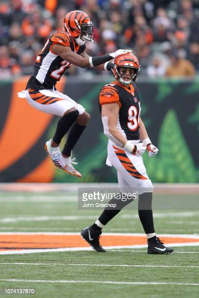 Sam Hubbard of the Cincinnati Bengals is congratulated by Dre Kirkpatrick after forcing a fumble during the first quarter of the game against the...