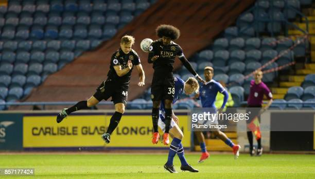 Sam Hughes and Hamza Choudhury of Leicester City in action during the EFL Checkatrade Trophy tie between Carlisle United and Leicester City at...