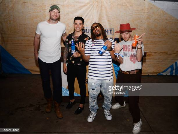 Sam Hunt Chris Carrabba Lil Jon and Harry Hudson backstage at the Bud Light Getaway at Riverfront Park on July 14 2018 in North Charleston South...