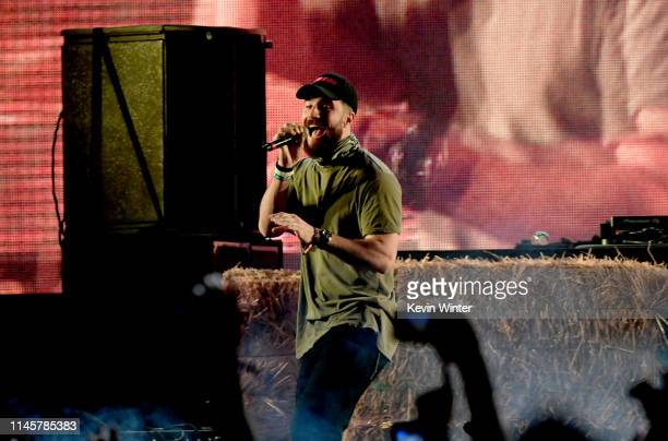Sam Hunt performs with Diplo onstage during the 2019 Stagecoach Festival at Empire Polo Field on April 28 2019 in Indio California
