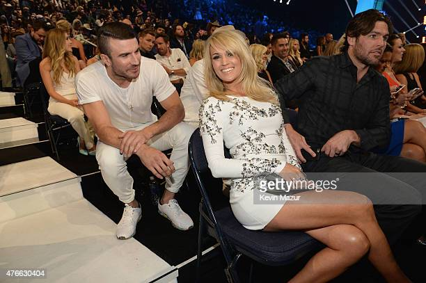 Sam Hunt Singer Carrie Underwood and her husband Mike Fisher attend the 2015 CMT Music awards at the Bridgestone Arena on June 10 2015 in Nashville...