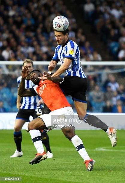 Sam Hutchinson of Sheffield Wednesday battles for the ball with Kazenga LuaLua of Luton Town during the Sky Bet Championship match between Sheffield...