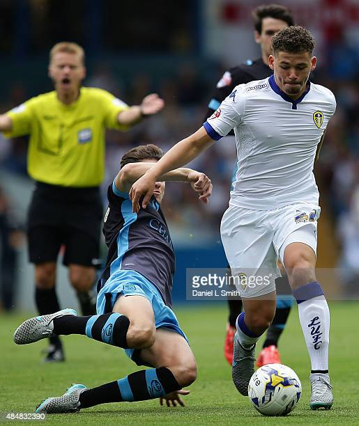 Sam Hutchinson of Sheffield Wednesday FC slide tackles Kalvin Phillips of Leeds United FC during the Sky Bet Championship match between Leeds United...