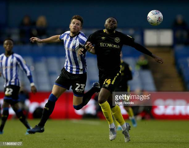 Sam Hutchinson of Sheffield Wednesday is challenged by Josh Dasilva of Brentford during the Sky Bet Championship match between Sheffield Wednesday...