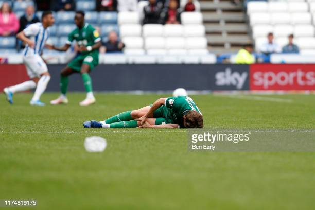Sam Hutchinson of Sheffield Wednesday lies on the pitch after taking a knock during the Sky Bet Championship match between Huddersfield Town and...