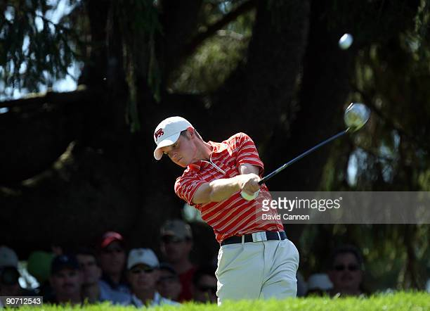Sam Hutsby of England and the Great Britain and Ireland Team tees off at the 3rd hole against Drew Weaver of the USA during the final afternoon...