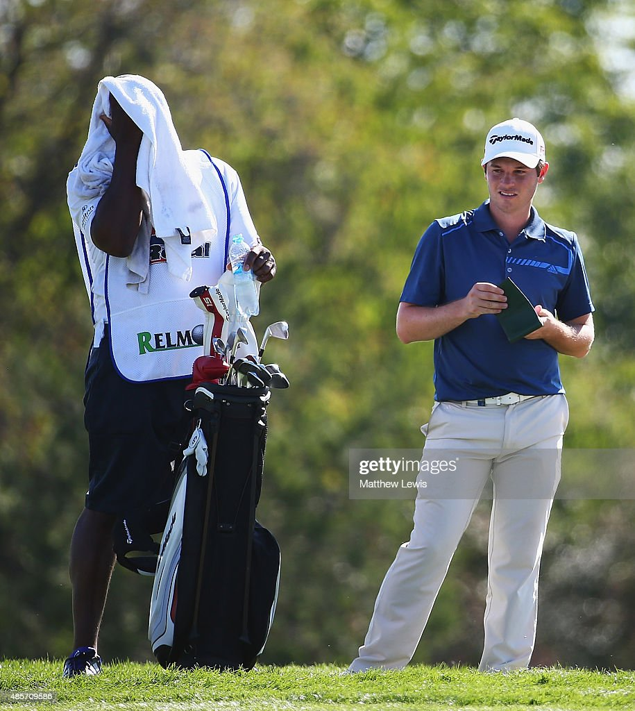 Sam Hutsby of England looks on, as his caddie feels the heat during day three of the D+D Real Czech Masters at Albatross Golf Resort on August 29, 2015 in Prague, Czech Republic.