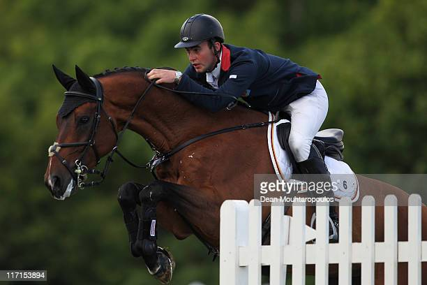 Sam Hutton of Great Britain riding Lancelot TN competes in The Bunn Leisure Derby Tankard during the British Jumping Derby Meeting on June 23 2011 in...