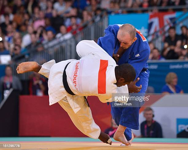 Sam Ingram of Great Britain uses a hand throw to flip Dartanyon Crockett of the USA onto his back for ippon in the quarterfinals on his way to the...