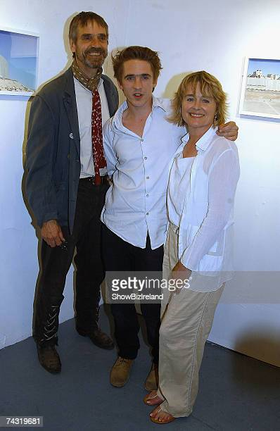 Sam Irons the son of Jeremy Irons and Sinead Cusack poses with his parents as they exhibit photographs of the security wall between Israel and...
